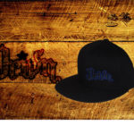 Black fitted flat bills w/ blue outlined logo