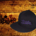 Black fitted flat bills w/ purple outlined logo