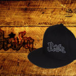Black fitted flat bills w/ white outlined logo